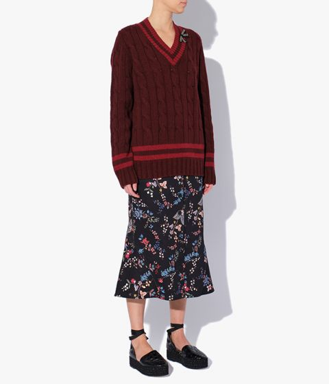 Burgundy jumper interspersed with red stripes which give it a distinct collegiate feel.