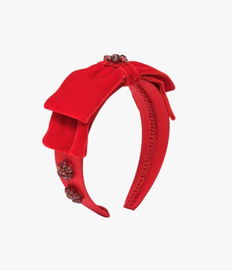 Introduce bold colour and texture to daytime or evening looks with this red headband from Erdem.