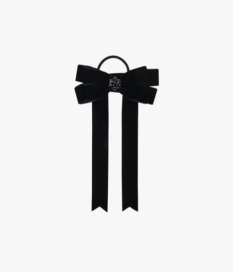 Velvet hair tie in a bow, embellished with a crystal at the centre for added interest.