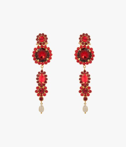 These earrings made in Italy from gold-tone brass and showcase bold red crystals of varying sizes.