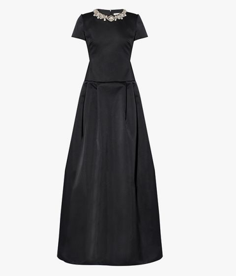 Exuding an air of timeless sophistication, the Alphonse Gown is meticulously crafted from black duchesse satin.