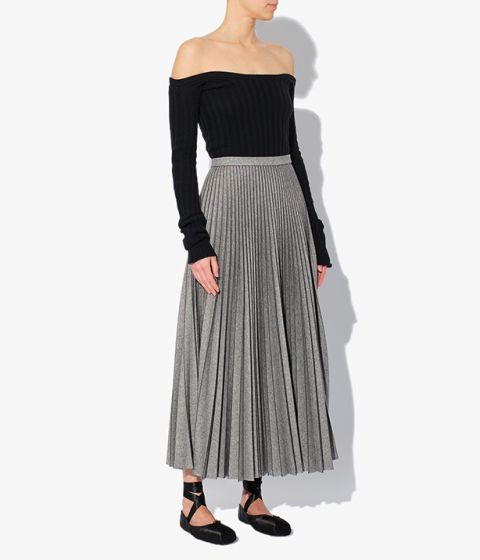 The midi length Nesrine Skirt is precisely pleated to create a balanced sense of structure and movement.
