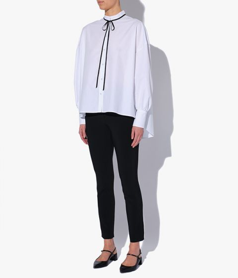 Drop shoulders and an asymmetric hem create a relaxed silhouette on this shirt.