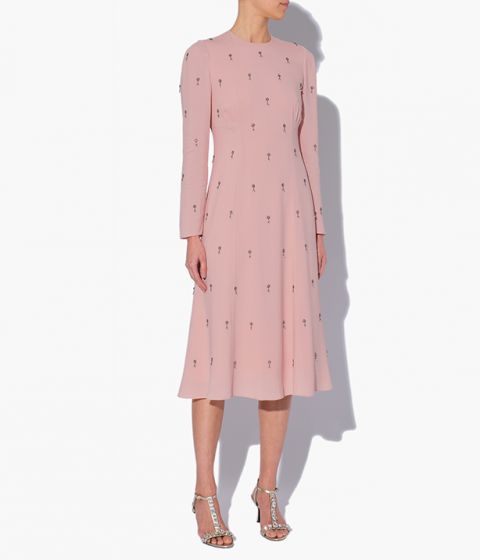 The Ivor Dress from Erdem is cut from pink crepe and decorated with delicate floral embroidery and beads.
