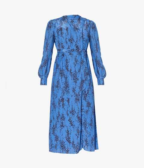 The Louvenia Dress is crafted with a wrap-style neckline and long blouson sleeves.