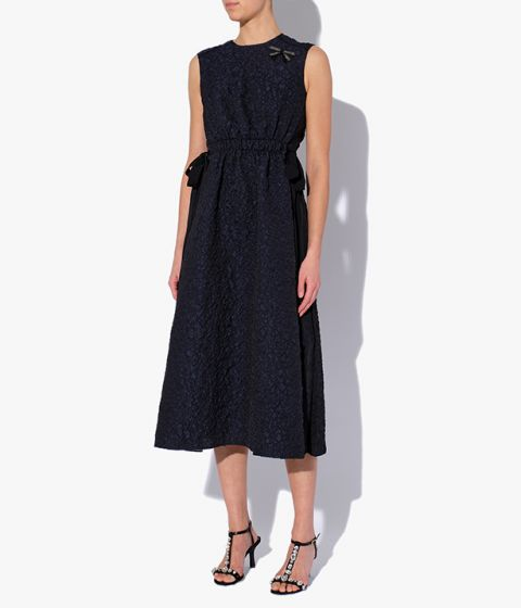 Sleeveless dress which has a gathered waist complete with grosgrain ribbons at the sides.