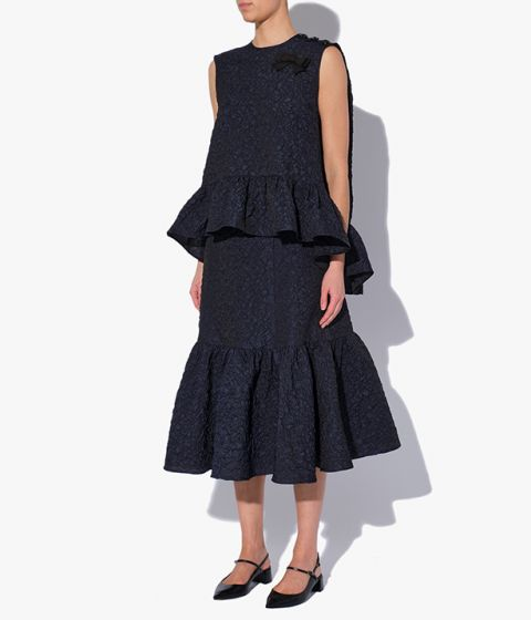 Erdem Lue Skirt is shaped with a dramatic tiered hem that falls to a below-the-knee length.