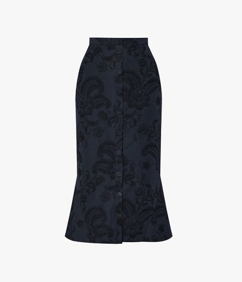 The Frances Skirt is fitted through the hips, and flaring out at the hem.