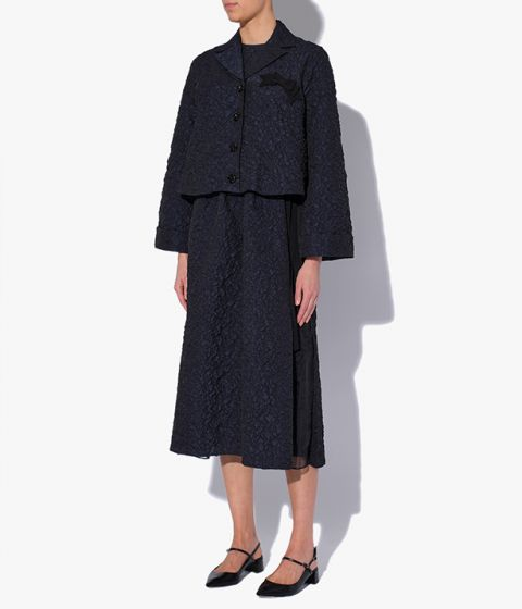 Waneta Jacket in navy cloqué that's embossed with a textural pattern.