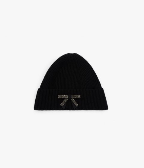 Knitted from black wool, this classic beanie is given a feminine update with bow embellishment.