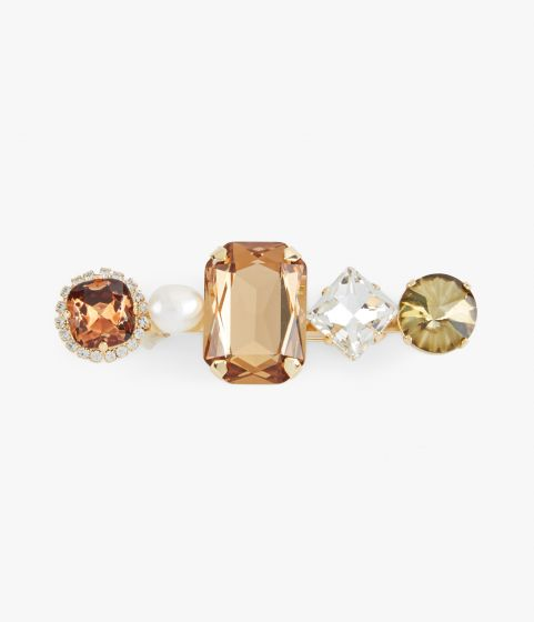 Ssmoked topaz brooch from Erdem which showcases a line-up of faceted crystals and a faux pearl.