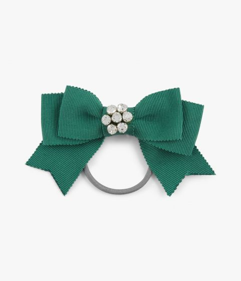 Bow-adorned hair tie in a vivid shade of green with a crystal centre.