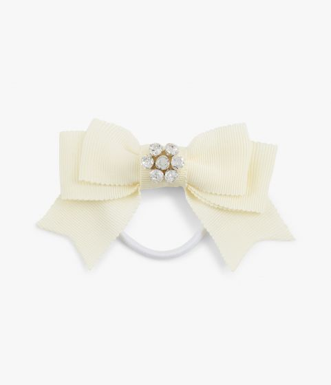 Update your everyday ponytail with this cream hair tie.